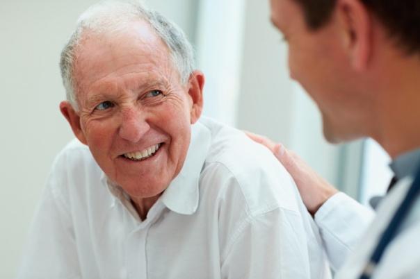 Elderly gentleman pat on the back